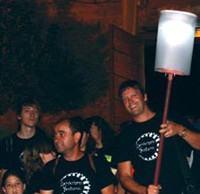 Olive Press editor Jon Clarke carries the beacon to lead Priego de Cordoba's annual nocturnal walk